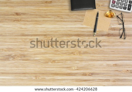 abstract wood table with note and calculate for cover or background