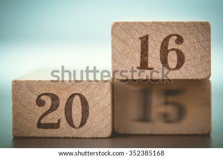 Abstract year 2016 number on wood block is coming concept. Happy New Year 2016 replace blur 2015 concept - stock photo