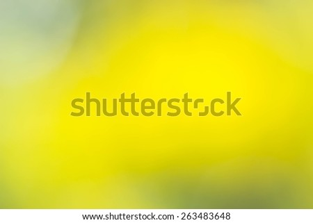 Abstract yellow nature background, blurred by camera - stock photo