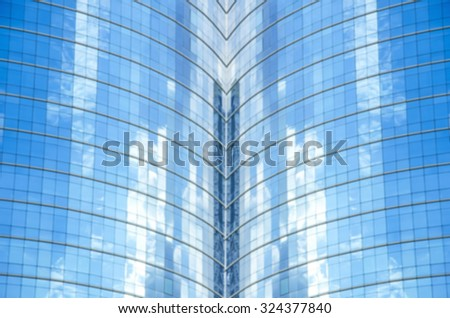 Abstracted blurry background of mirror reflecting the bright blue sky