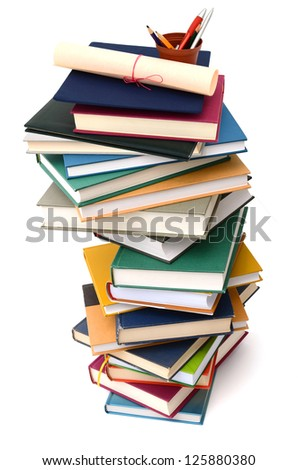 Abstracting on high pile books with graduation day - stock photo