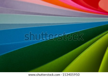 abstraction from the coloured paper as a background - stock photo