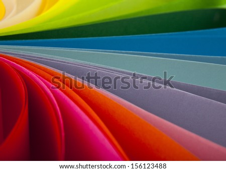 abstraction from the coloured paper as a background. One picture from series. - stock photo