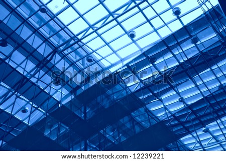 abstraction, metallic-glass design of the ceiling and wall of the modern office building