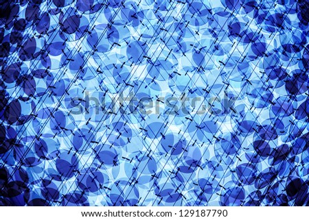 abstraction with glass decorations and blue light