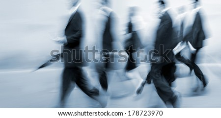 abstrakt image of business people in the street and modern style with a blurred background and blue tonality - stock photo