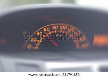 abstrakt image with blurred speedometer car and blue tonality