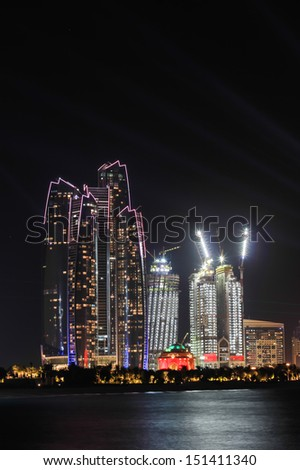 ABU DHABI, AUH/UAE - DEC. 4 : Etihad Towers on the December 4th 2011 lighted by emirates flag colors on the national day of UAE - stock photo
