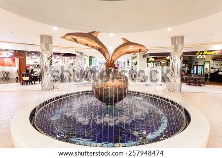 ABU DHABI - DEC 21: Dolphin fountain inside of the Marina Mall in Abu Dhabi. December 21, 2014 in Abu Dhabi, United Arab Emirates - stock photo