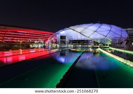 ABU DHABI - DEC 19: Ferrari World Theme Park illuminated at night. December 19, 2014 at the Yas Island in Abu Dhabi, UAE - stock photo