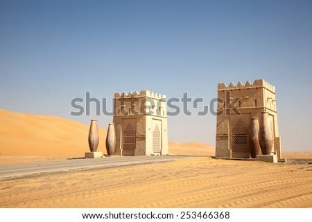ABU DHABI - DEC 22: Gate to the Qasr Al Sarab Desert Resort Hotel in Abu Dhabi. December 22, 2014 in Liwa Desert, United Arab Emirates - stock photo
