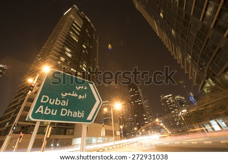 Abu Dhabi Dubai road Bord - stock photo