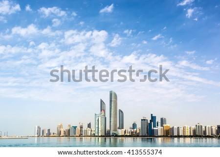 Abu Dhabi, EAU - December 15th 2015 - The famous skyline of Abu Dhabi in a blue sky day, Abu Dhabi, EAU. - stock photo