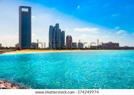 Abu Dhabi, Emirates Palace and skyscraper on the beach. UAE - stock photo