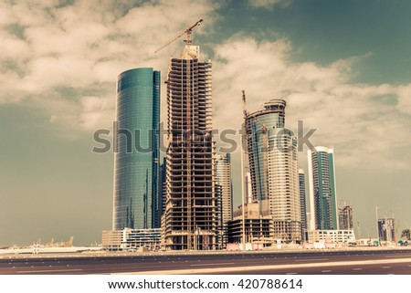 Abu Dhabi new district with skyscrapers construction. United Arab Emirates - stock photo