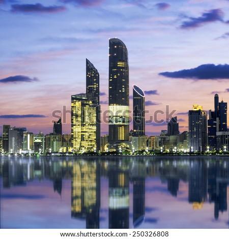Abu Dhabi Skyline at sunset, United Arab Emirates  - stock photo
