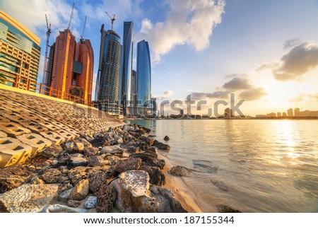 Abu Dhabi, the capital of United Arab Emirates at sunrise - stock photo