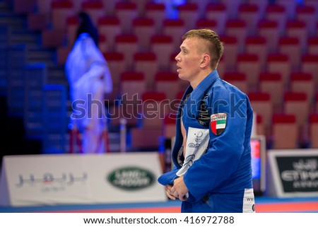 ABU DHABI, UAE - APRIL 19, 2016: ABU DHABI WORLD PROFESSIONAL JIU-JITSU CHAMPIONSHIP 2016 in the IPIC ARENA. Fighter in the blue kimono.