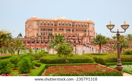 ABU DHABI, UAE - APRIL 27: Emirates Palace hotel facade on April 27, 2014, UAE. Seven stars Emirates Palace is the second most expensive hotel ever built for about 6 billion USD. - stock photo
