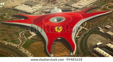 ABU DHABI, UAE -  APRIL 07: Ferrari World Park is the largest indoor amusement park in the world. Abu Dhabi on April 07, 2012. Bird's eye view - stock photo