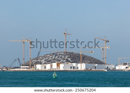 ABU DHABI, UAE - DEC 19: Louvre Abu Dhabi museum construction site. December 19, 2014 in Abu Dhabi, United Arab Emirates - stock photo