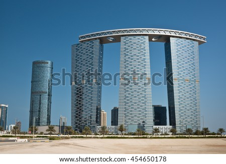 ABU DHABI, UAE - DECEMBER 24: Abu Dhabi streets with The Gate Towers skyscrapers on December 24, 2014. United Arab Emirates
