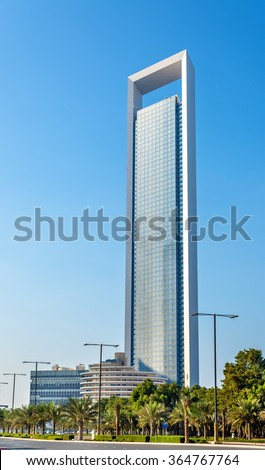 ABU DHABI, UAE - DECEMBER 29: ADNOC Headquarters skyscraper on December 29, 2015. The tower 342 meters tall was completed in 2014 - stock photo