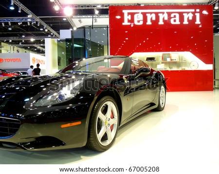 ABU DHABI, UAE - DECEMBER 10: Ferrari California on display during Abu Dhabi Int'l Motor Show 2010 at Abu Dhabi Int'l Exhibition Centre December 10, 2010 in Abu Dhabi,United Arab Emirates. - stock photo