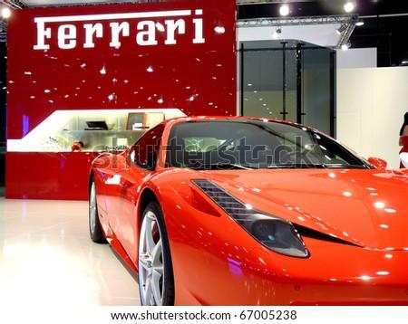 ABU DHABI, UAE - DECEMBER 10: Ferrari 458 Italia on display during Abu Dhabi Int'l Motor Show 2010 at Abu Dhabi Int'l Exhibition Centre December 10, 2010 in Abu Dhabi,United Arab Emirates. - stock photo