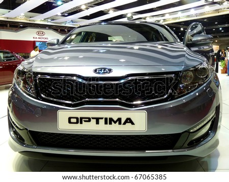 ABU DHABI, UAE - DECEMBER 10:KIA Optima on display during Abu Dhabi Int'l Motor Show 2010 at Abu Dhabi Int'l Exhibition Centre December 10, 2010 in Abu Dhabi,United Arab Emirates.