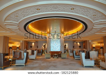 ABU DHABI, UAE - FEB 15: Interior of Emirates Palace Hotel in Abu Dhabi, UAE, as seen on Feb 15, 2014. It is a seven star luxury hotel and has its own marina and helipad.