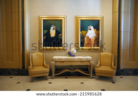 ABU DHABI, UAE - FEB 25: Pictures of the Sheikhs on the wall of Emirates Palace. February 25, 2010 in Abu Dhabi, United Arab Emirates - stock photo