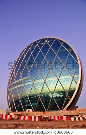 ABU DHABI, UAE - JANUARY 29: The unique HQ building is office accommodation, taken January 29, 2010 in Abu Dhabi. It was voted the Best Futuristic Design 2008 by the Building Exchange Conference - stock photo