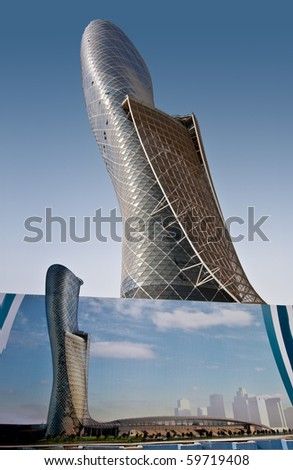 ABU DHABI, UAE - JULY 23: The Capital Gate tower still under construction on July 23, 2010 in Abu Dhabi.  This is certified as the Worlds Furthest Leaning Manmade Tower by Guiness World Records