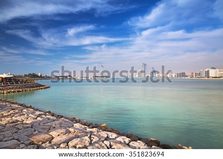 ABU DHABI, UAE - MARCH 29, 2014: Cityscape of Abu Dhabi, capital city of UAE. Abu Dhabi is the capital and the second most populous city in the United Arab Emirates with around 1 million people. - stock photo