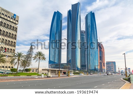 ABU DHABI, UAE - MARCH 29: Etihad Towers buildings in Abu Dhabi on March 29, 2014, UAE. Five towers complex with 74 floors is the third tallest building in Abu Dhabi. - stock photo