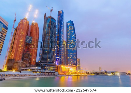 ABU DHABI, UAE - MARCH 25: Etihad Towers buildings in Abu Dhabi on March 25, 2014, UAE. Five towers complex with 74 floors is the third tallest building in Abu Dhabi. - stock photo