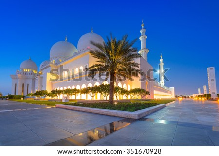 ABU DHABI, UAE - MARCH 27, 2014: Sheikh Zayed Grand Mosque in Abu Dhabi, UAE. Grand Mosque in Abu Dhabi is the largest mosque in the United Arab Emirates for more than 40,000 prayers. - stock photo