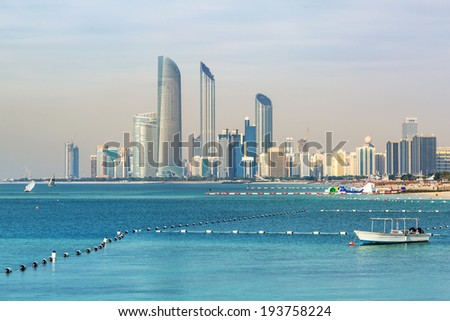 ABU DHABI, UAE - MARCH 29: Skyscrapers at Persian Gulf in Abu Dhabi on March 29, 2014, UAE. Abu Dhabi is the capital and the second most populous city of the United Arab Emirates. - stock photo