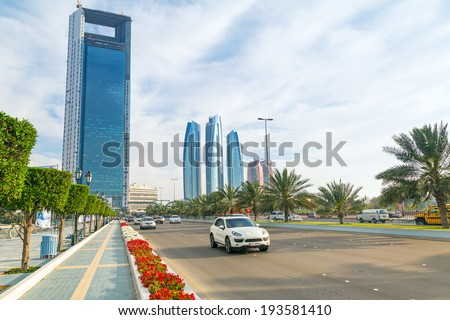 ABU DHABI, UAE - MARCH 29: Streets of Abu Dhabi with skyscrapers on March 29, 2014, UAE. Abu Dhabi is the capital and the second most populous city of the United Arab Emirates. - stock photo