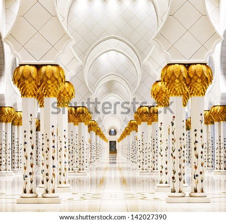 ABU DHABI, UAE - MAY 11: Sheikh Zayed Grand Mosque, Abu Dhabi, UAE on May 11, 2013 in Abu Dhabi. The 3rd largest mosque in the world, area is 22,412 square meters and the 4 minarets are 107 m high - stock photo