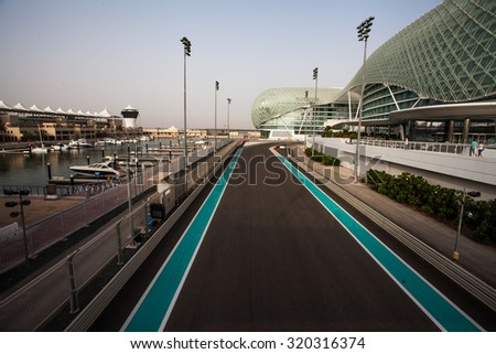 Abu Dhabi, UAE- May 13,2014: The Yas Circuit and Hotel - the iconic symbol of Abu Dhabi's Grand Prix. It is the first new hotel in the world to be built over an F1 race circuit - stock photo
