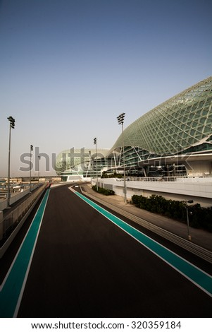 Abu Dhabi, UAE- May 13,2014: The Yas Hotel - the iconic symbol of Abu Dhabi's Grand Prix. It is the first new hotel in the world to be built over an F1 race circuit - stock photo