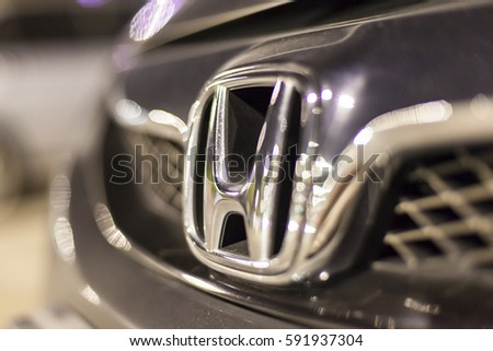 ABU DHABI, UAE - NOV 26, 2016: Honda company logo on a car illuminated at night