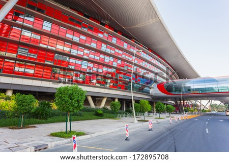 ABU DHABI, UAE - NOVEMBER 5: Ferrari World Park is the largest indoor amusement park in the world. The roof has a total surface area of 200,000 m2. Abu Dhabi on November 5, 2013. - stock photo