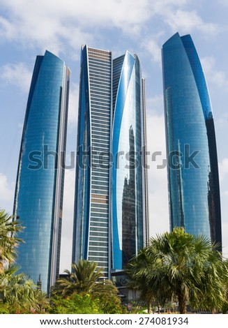 ABU DHABI, UAE - NOVEMBER 5, 2013: Modern high-rise office buildings - stock photo