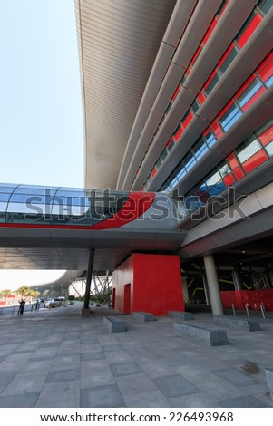 Abu Dhabi, UAE - October 10, 2014: Exterior of the Ferrari World at Yas Island in Abu Dhabi, United Arab Emirates - stock photo