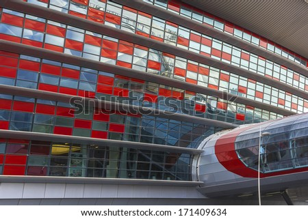 ABU DHABI, UAE - OCTOBER 1, 2012: The exterior of Ferrari World at Yas Island in Abu Dubai in the United Arab Emirates. Ferrari World - the largest indoor amusement park in the world. - stock photo