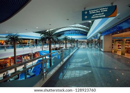 ABU DHABI, UNITED ARAB EMIRATES - APRIL 12: Interior of the Marina Mall April 12, 2012 in Abu Dhabi, United Arab Emirates. This is the biggest shopping mall in Abu Dhabi - stock photo