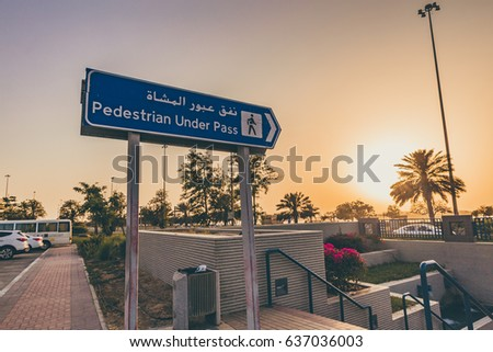 ABU DHABI, UNITED ARAB EMIRATES - MAY 5, 2017: A wide angle shot of pedestrian signage during sunset in Abu Dhabi.